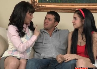 Stud gets his hard pecker satisfied by two bewitching hotties