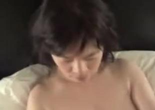 Horny Japanese milf Kui Somya masturbation watching video