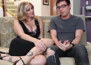 Dane Cross and plump breasted cougar Julia Ann are having some good time on the couch and they look very pretty and rather lascivious in many ways.
