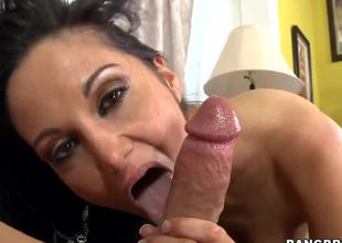 Dark haired and arousing milf Ava Addams with big tits gives an amazing oral-stimulation session on the couch after shes done playing with her big black dildo sex toy int he room.
