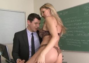 Now this charming milf Julia Ann tries to seduce pretty fellow in business suit to have some fun with her in a classroom. Beauty starts undressing not fast before him.