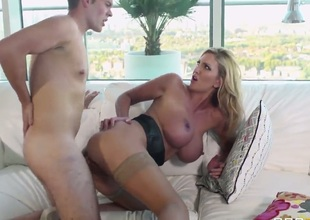 Leigh darby is a young milf with a giant pair of boobs. Her bf just likes to take her on the sofa and put his hard cock deep inside her yummy vagina while she moans really loud.Leigh ends up swallowing his hot jizz in the end