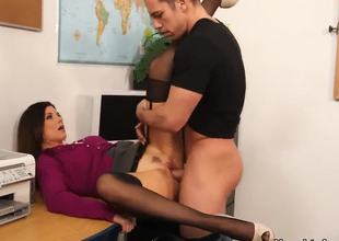 Messy long haired seductive brunette milf India Summer with tight body dressed to arouse acquires her trimmed minge licked by young muscled fellow Johnny Castle in hot school fantasy.