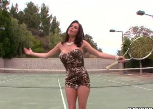 Turned on glamorous brunette milf Veronica Avluv with massive fake tits and large juicy ass in slutty dress is hungry for cock and teases outdoor at the tennis court hoping to score.
