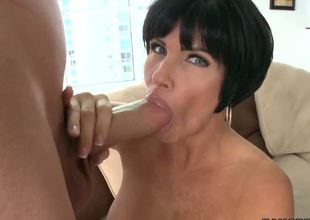 Turned on cock hungry black haired mature cougar Shay Fox with massive firm balloons and big juicy ass rubs her shaved minge and gives lusty blowjob to young guy with huge cock.
