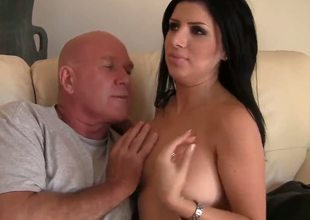 Dirty old fucker Maestro Claudio gets tempted in living room by black haired sexy milf Sativa Rose with huge breathtaking hooters and juicy ass in provocative fishnet dress