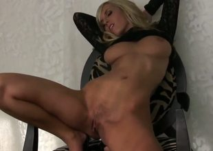 Attractive experienced blonde milf Chikita with massive stunning knockers and tight ass in arousing black lace blouse teases and rubs her bald sweet pussy in provocative positions