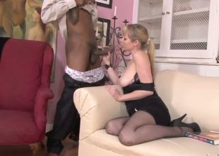 Seductive milf brunette Adrianna Nicole with big juicy hooters in stockings, high heels and sexy black dress gives great oral-job to turned on black stud Tone Capone with huge cock