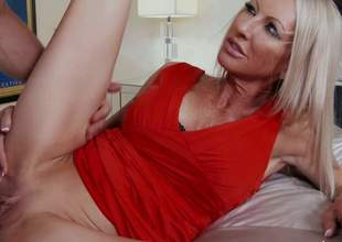 Emma Starr is his good looking mature woman with slender figure and really tight bald pussy. Johnny Castle drills her tight pink aperture with wild desire. She gets her twat banged with her long legs apart without taking off her sexy short red costume