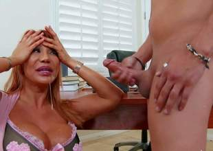 Asian milf Ava Devine finds Xander Corvus sexy and gives him sex lesson he wont soon forget. Hot big titted mom gets down on her knees in front of student guy in her office. She sucks his dick with appetite before titty fuck