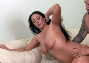 Seductive ball sucking milf with big natural tits and long black hair gives lusty irrumation to blonde stud with many tattoos and gets pounded doggy position on a lazy afternoon