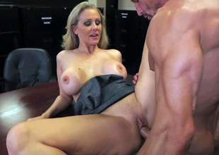 Attractive experienced and cock loving blonde milf Julia Ann with big fake tits and round bouncing ass in hot outfit seduces muscled Tommy Gunn and receives banged in the office
