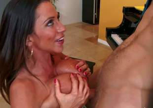 Ariella Ferrera is a seductive big titted milf brunette that cant wait to take young guys hard dick in her pussy. She gives head and gives unthinkable titjob before she takes his rod up her thirsty pussy
