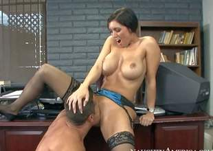 Dylan Ryder is a big boobed milf that has unthinkable sex with one of her students behind the closed door of her office. Big racked brunette in stockings gets her experienced pussy eating after sucking his young dick with passion