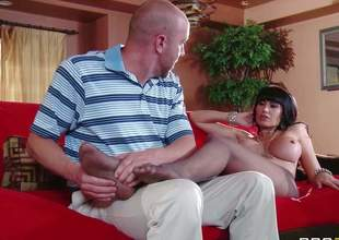 Dark haired bombshell milf Eva Karera with big firm balloons in hose only gets her feet massaged by young buck Will Powers and gives him memorable oral-job in living room