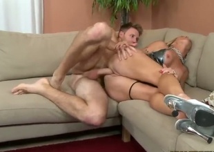 Turned on arousing and tempting blonde cougar with big firm hooters and long legs in stripper shoes tempted young tall guy and gets fingered to wet orgasm in living room.
