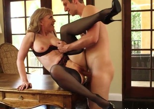 Mature doxy Nina Hartley put on her sexiest clothes with stocking and high heels on she seduces a young stud Danny Wylde and made him fuck her like she hasnt been fucked in ages