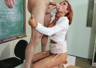 Attractive redhead teacher Vronica Avluv with big juicy tits and round bouncing bums in high heels and white shirt seduces rebellious student Preston Parker and rides on his cock.