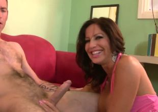 With an insatiable appetite for dick, horny cougar Tara Holliday goes right after his cock, swallowing it all the way down her throat before its her turn to get oral.