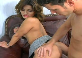 Sabrina is a real cougar that shamelessly seduces younger guys and drags them home for a night of steamy sex...She rides on the guy in reverse cowgirl and gets nailed on the couch!