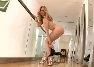 Gorgeous blonde milf Sandy takes off her clothes and plays with her pussy