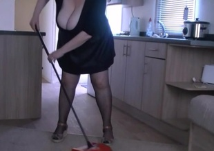 Doing the housework in my leather look skirt