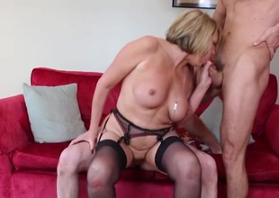 Talented mature slut makes two juvenile guys feel good