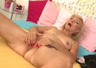 Wrinkled granny fingering her lovely bald pussy