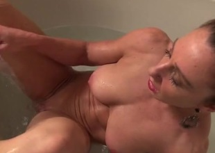Fit and wet mom masturbating in the bathtub