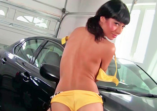 Lily Evans is playing with her sexy pussy by a car