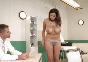 Busty brunette Fleshly Jane rides her doctors large cock