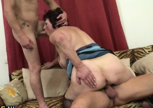Two young studs sharing a mature cunt