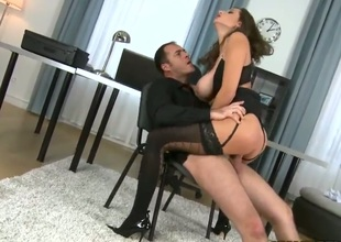Jane is a smoking hot brunette with big boobs. She is at the office having a business meeting with this guy. You can sense the chemistry in the air and the next thing you know Jane in nylon stockings is riding on his monster tadger.