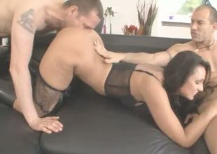 Sexy arse dark haired babe Lioness in lace lingerie and black boots with high heels takes on 2 hard rods in threesome sex with Ian Scott and Mike Angelo in living room