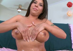 The pretty brunette milf Candy Cox definitely knows how to satisfy her excited body and this babe sexily plays with big boobs and tenderly rubs the nice hairless twat