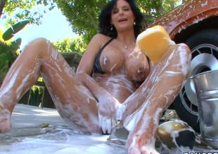 The kinky milf with big tits and big round booty Phoenix Marie is outdoor washing the car and also foaming her own sexy body that is stretched and ready for masturbation
