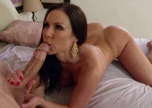 This guy finds his buddys mom Kendra Lust sleeping in the bedroom. Lovely pantyless woman attracts his attention. This guy takes pictures of her bare bubble ass and then pulls out his cock. Busty milf doesnt mind having sex with hot boy after waking up