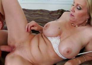 Curvy big titted mature blonde Julia Ann is his buddys sexy mother. She sucks his hard young 10-Pounder and then removes her white panties to takes it in her oozing wet pussy. Watch big titted milf get shagged!