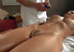Milf Janet Mason pays a visit to the best masseur in town Bill Bailey. He massages her neat feet at first but her amazing nude body turns him on. He cant keep his hands off her big ass and her massive titties