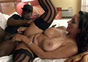 Rico Shades is a black guy that loves fucking sexy white milfs like this one. Big breasted mature beauty in black stockings gets her pussy penetrated on the bed after great interracial titjob