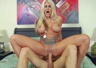 Michelle McLaren is a devilishly sexy blond-haired milf with perfect huge knockers. Tattooed milf demonstrates her juggs as this babe gets her shaved pussy fucked hard on the bed. She takes breast jizz flow after hard sex