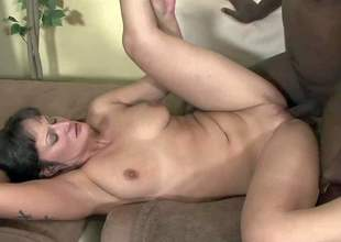 Santina Marie is s sexy bodied slim white milf with pretty small natural tits, long legs and smooth pussy. She gives deep blowjob to big dicked ebony guy and then takes his jock in her vagina