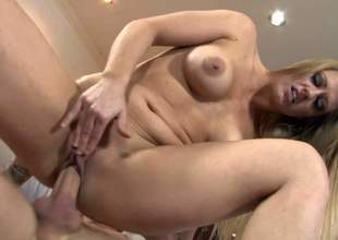 Holly Heart is a sexy bodied milf with lovely fake tits. This babe strips out of her dress and pants while sucking chaps hard dick. Then she takes his love bone up her totally smooth pussy