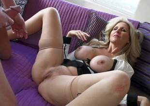 Julia Ann is a sex obsessed large titted older beauty that licks guys balls and sucks his stiff cock like crazy before she spreads her legs wide on the edge of the sofa and takes love torpedo in her wet hole