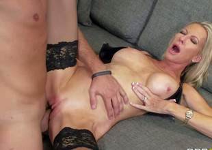 Busty and slutty blonde milf Emma Starr enjoys in getting her shaved beaver licked, fingered and rammed hard by her neighbor Keiran Lee on the living room couch and enjoys