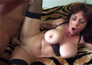 Karen Kougar is a good looking mature slut who can't live without hard sex so much. Experienced woman in black stockings parts her legs and gets her trimmed vagina fucked silly by her horny as hell fuck buddy