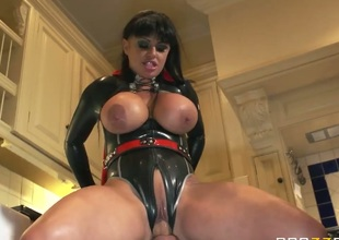 Kerry Louise is a Super MILF in sexy red and black super hero outfit. She shows off her amazing massive scoops as she gets her snatch banged by Danny D in the kitchen in this cock-hardening XXX parody.