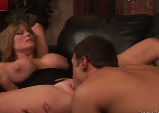 Rocco Reed is seducing beautiful milf with luxurious body Darla Crane to have sex with him. This babe wasnt against of it and now you could see him licking her sweet pussy.