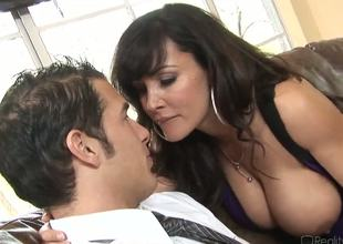 Chris Johnnson is a new sufferer to a horny cougar Lisa Ann and before he is able to escape that babe attacks him with her huge jugs and makes him lick her pussy.