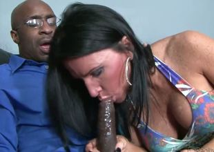 Busty and utterly lascivious cougar Kendra Secret gets to have some interracial action with Rock the Icon in front of her own husband and this babe can't live without it.